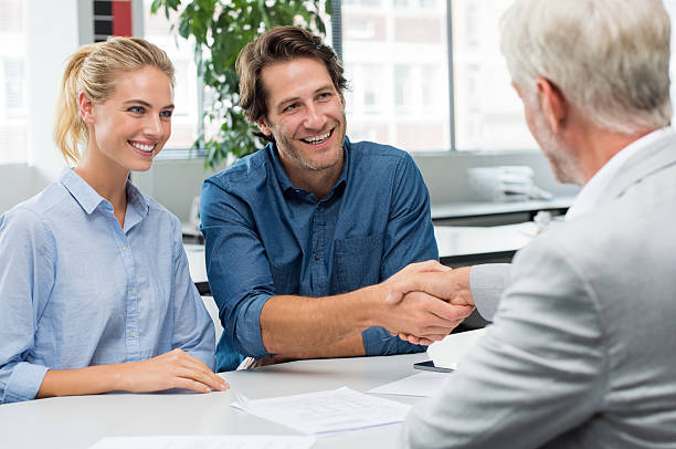 agreement with consultant - bankers stock photos and pictures