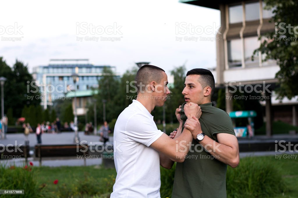 Agression between young adults stock photo
