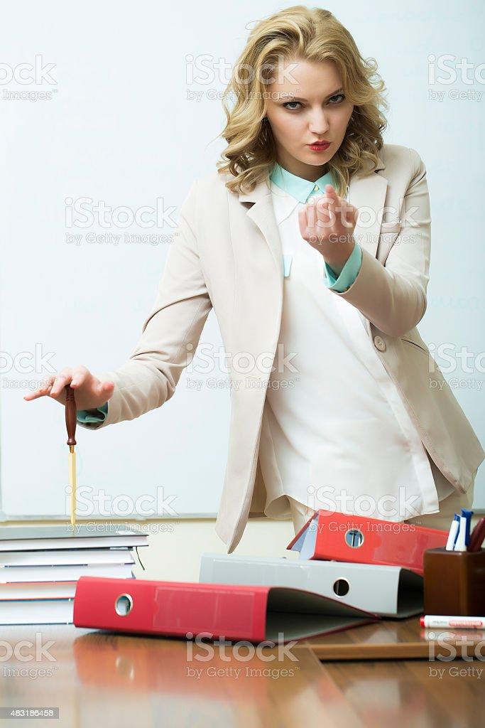 Agressive woman near office table stock photo