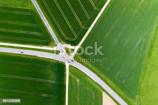 istock Agricultural area and thoroughfare - aerial view 684558988