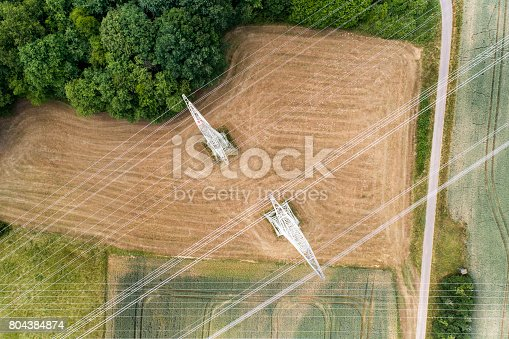 Agricultural area, fields, electricity pylons and transmission lines