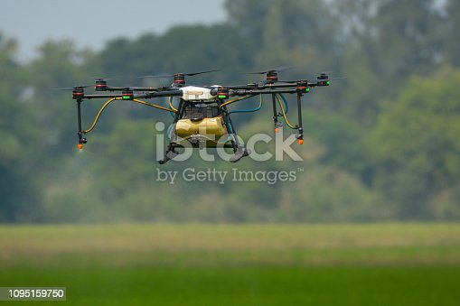 898449496 istock photo Agricultural drone working in rice field, Thailand, Smart Farm, Unmanned Aerial Vehicle. (UAV) 1095159750