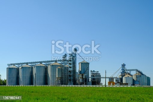 Agricultural factory with grain silos for storage and drying of grain crops. Agribusiness concept.