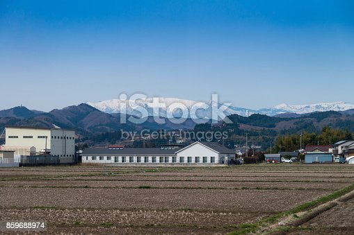 istock Agricultural field area and Agribusiness in the countryside, fukushima with azuma snow-capped mountains background view, japan 859688974