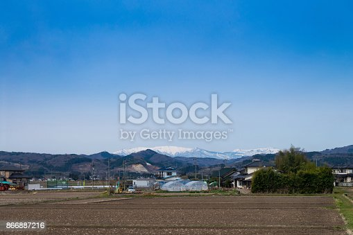istock Agricultural field area and Agribusiness in the countryside, fukushima with azuma snow-capped mountains background view, japan 866887216