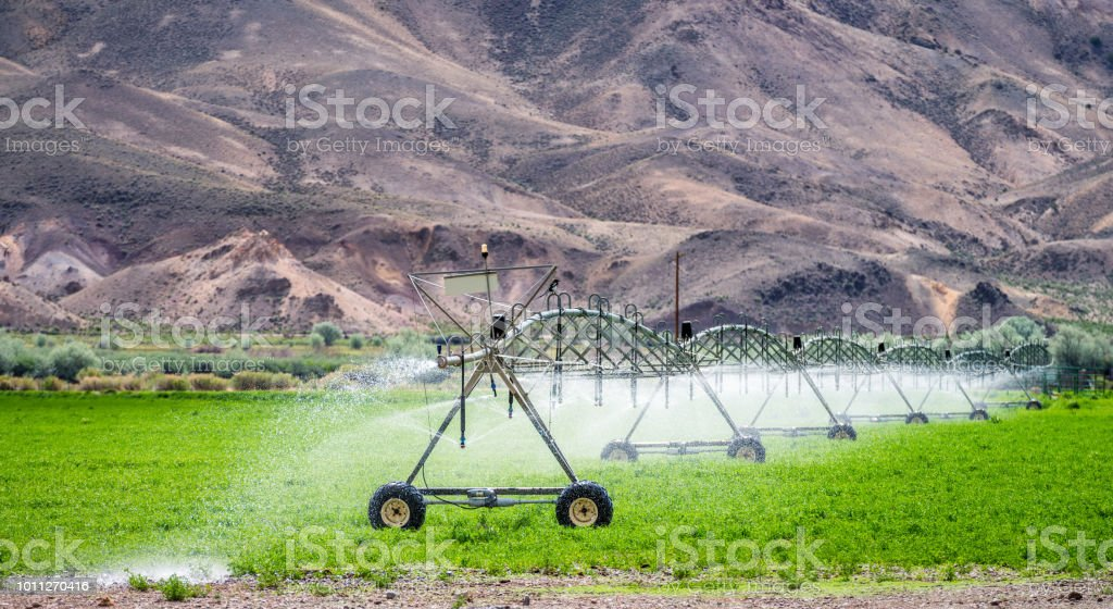 Agricultural irrigation of a field in dry countryside stock photo
