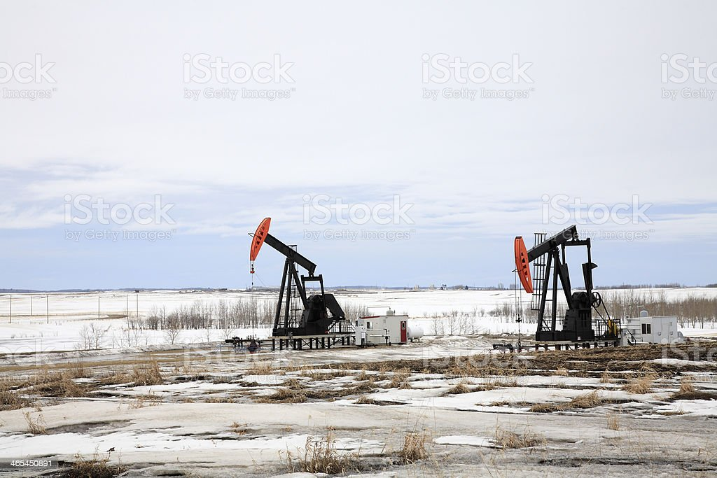 Agricultural Land In Winter With Oil Pump Jacks royalty-free stock photo