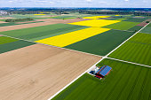istock Agricultural Landscape with Farm Barn, Aerial View 1284361124