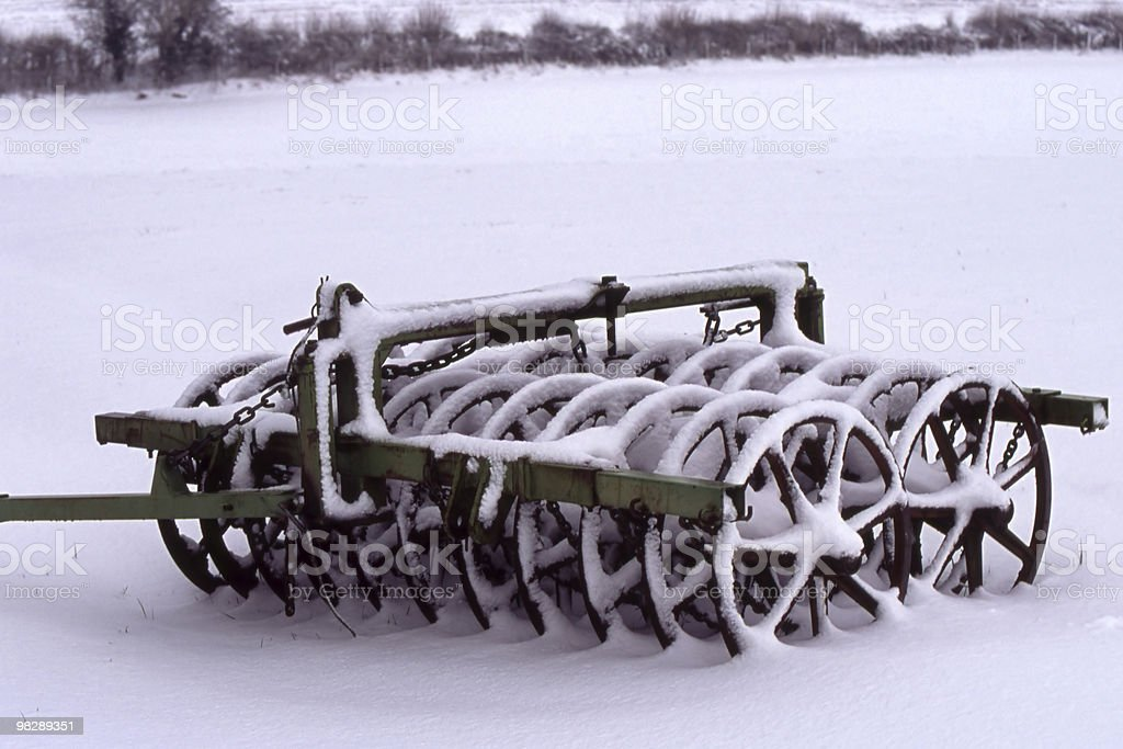 Agricultural Roller under snow royalty-free stock photo