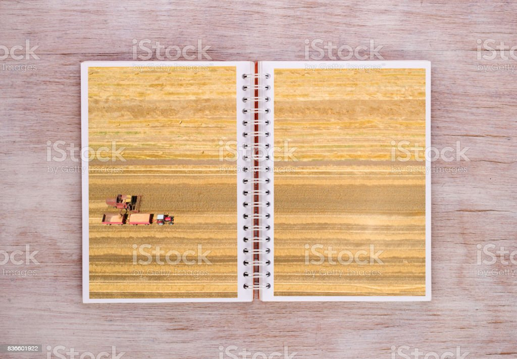 Agricultural scenes on pages of notebook stock photo