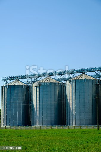 Agricultural Silos. Building for storage and drying of grain crops. Agribusiness concept.