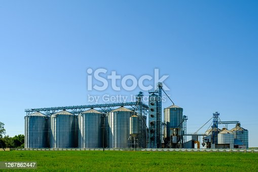 Agricultural Silos. Building for storage and drying of grains, wheat, corn. Agribusiness concept.