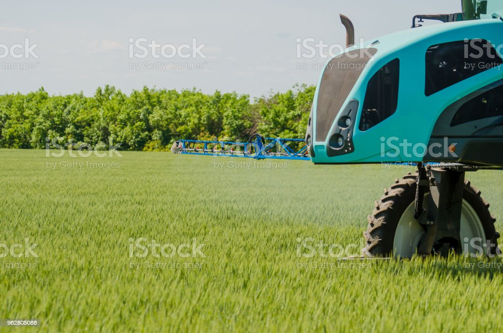 Agricultural Sprayers Spray Chemicals On Young Wheat Stock