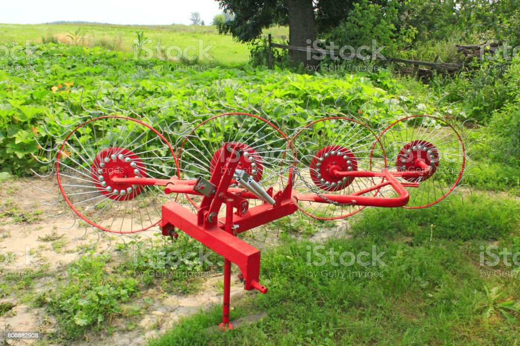 agricultural tractor equipment to collect the hay stock photo