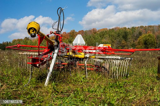 Agricultural windrow machine in a farm pasture