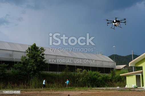 898449496 istock photo agriculture drone flying & spraying liquid fertilizer or herbicide in farm land. 1083334688