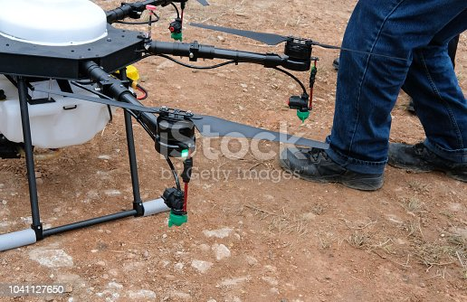 898449496 istock photo agriculture drone for spraying liquid fertilizer or herbicide in farm land. 1041127650