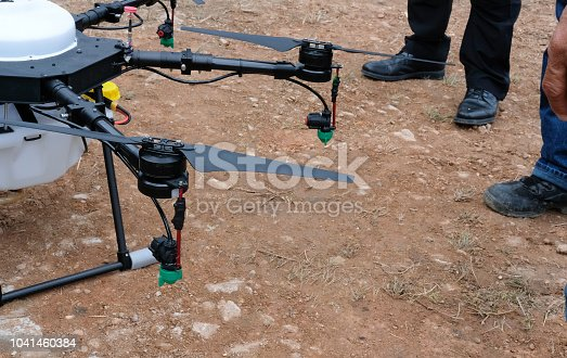 898449496 istock photo agriculture drone for spraying liquid fertilizer or herbicide in farm land. 1041460384