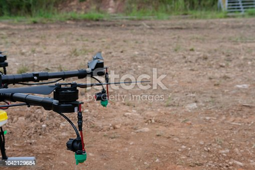 898449496 istock photo agriculture drone for spraying liquid fertilizer or herbicide in farm land. 1042129684