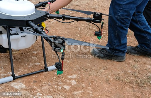 898449496 istock photo agriculture drone for spraying liquid fertilizer or herbicide in farm land. 1044528398
