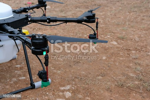 898449496 istock photo agriculture drone for spraying liquid fertilizer or herbicide in farm land. 1045106104