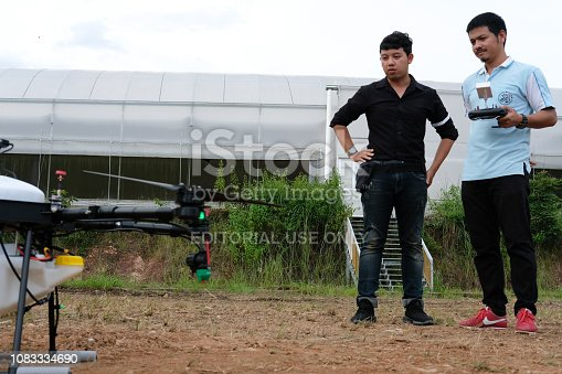 898449496 istock photo agriculture drone for spraying liquid fertilizer or herbicide in farm land. 1083334690