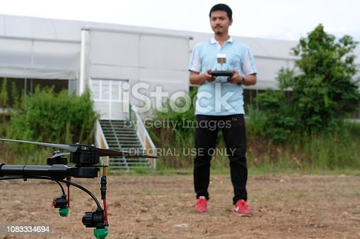 898449496 istock photo agriculture drone for spraying liquid fertilizer or herbicide in farm land. 1083334694
