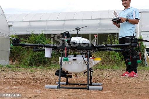 898449496 istock photo agriculture drone for spraying liquid fertilizer or herbicide in farm land. 1083334700
