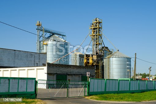 Agriculture factory. Agricultural grain silos. Building for storage and drying of grain crops.