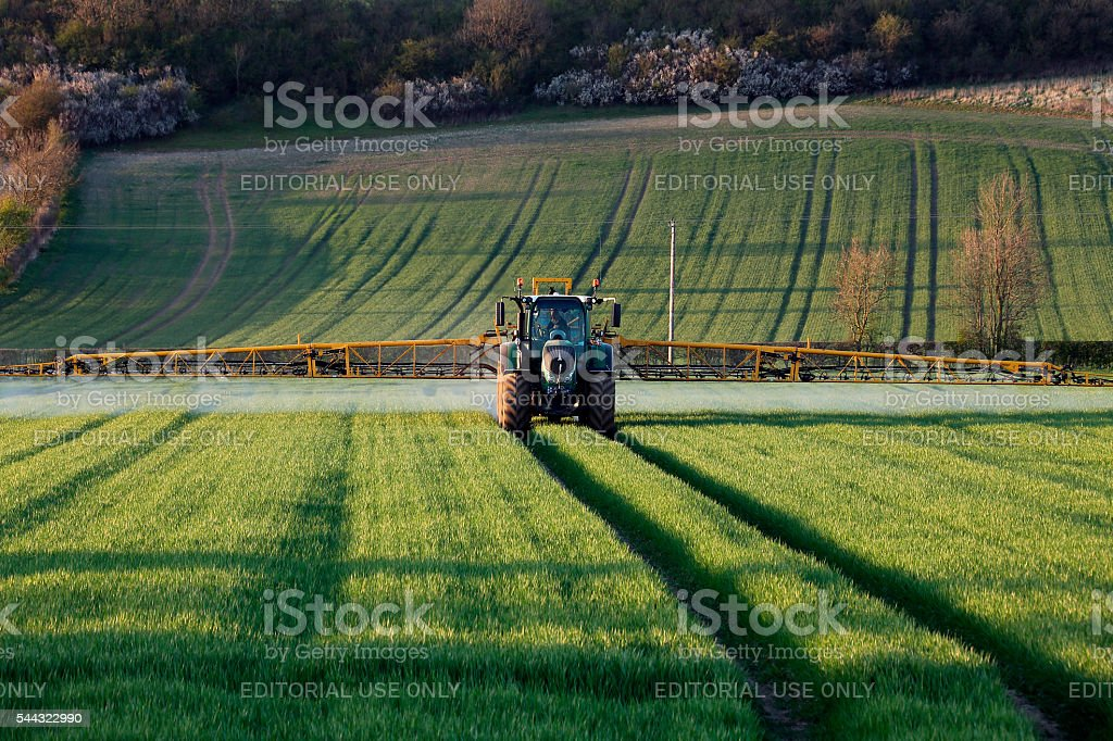 Agriculture - Farmer Spraying Crops stock photo