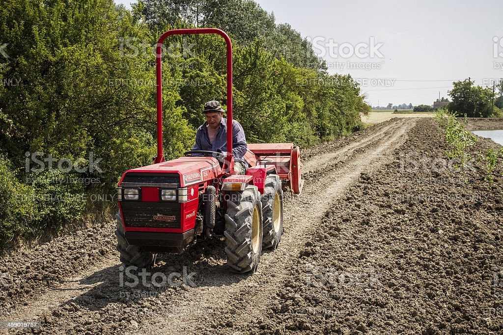 Agriculture in Italy: tractor at work royalty-free stock photo
