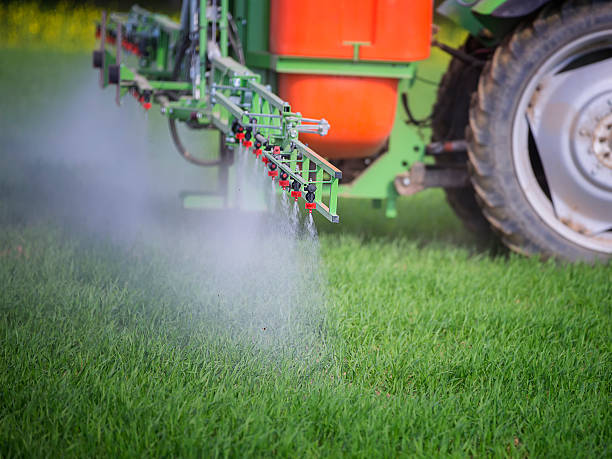 Agriculture Spraying of field in early summer herbicide stock pictures, royalty-free photos & images
