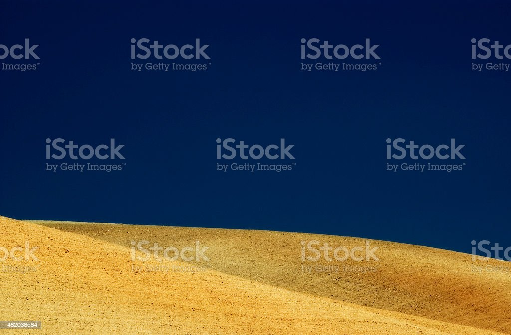 Agriculture, rolling hills of plowed fields, blue, yellow, Andalusia, Spain stock photo