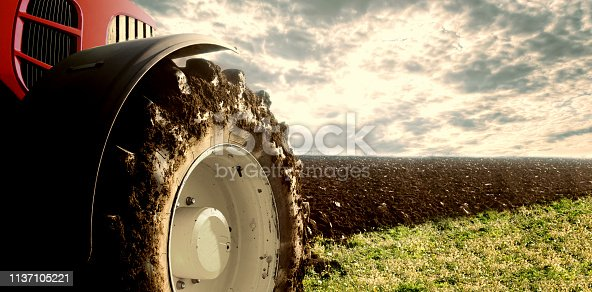 Agricultural machine in the field cultivating and preparing land for the next season.