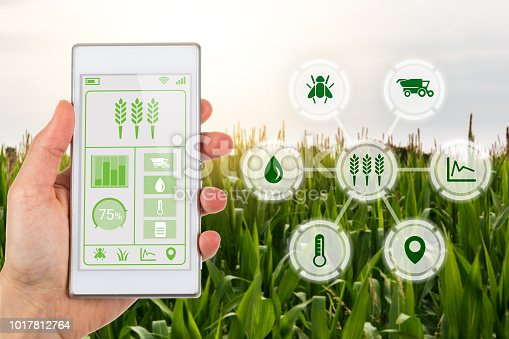 istock Agritech concept smartphone app with graphic display agricultural icons 1017812764