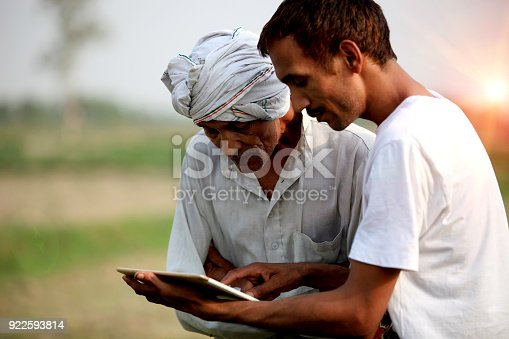 istock Agronomist consulting with farmer outdoor in the field 922593814
