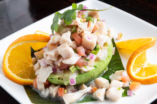 Aguacate con ceviche de pescado (seafood ceviche with avocado) stock photo