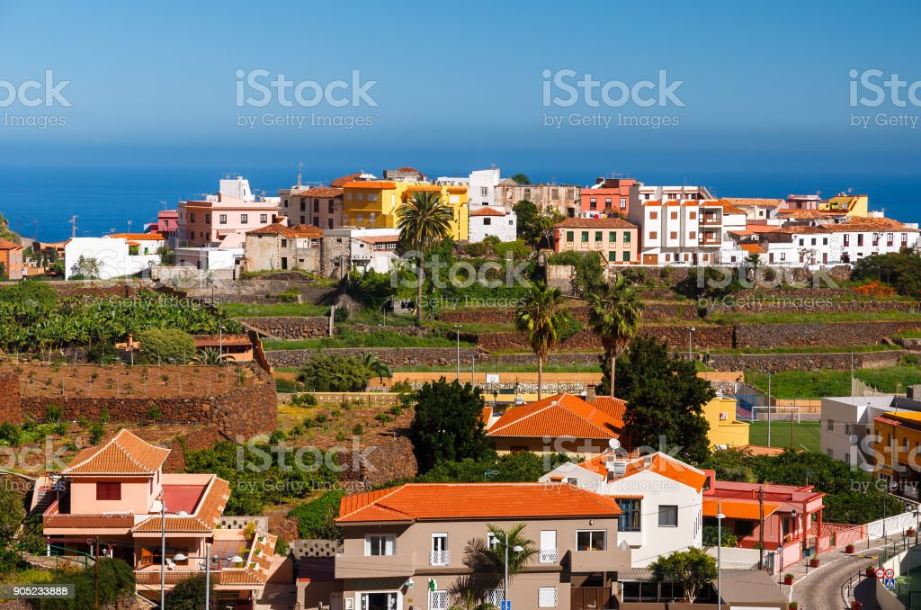 Agulo village view plantation banana buildings colourful ocean blue, La Gomera, Canary Islands, Spain stock photo