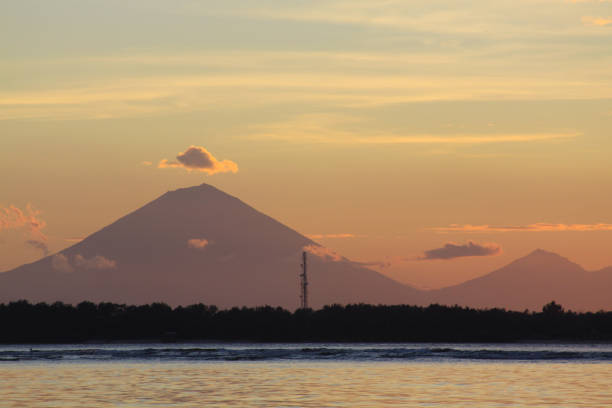 Agung volcano from Bali seen in the distance stock photo