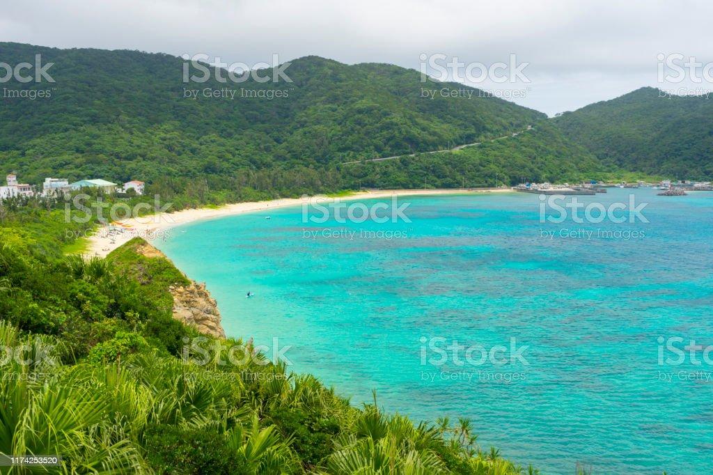Aharen Beach on Tokashiki Island in Okinawa, Japan. Tropical paradise landscape at Aharen Beach on Tokashiki Island in Okinawa, Japan. Bay of Water Stock Photo