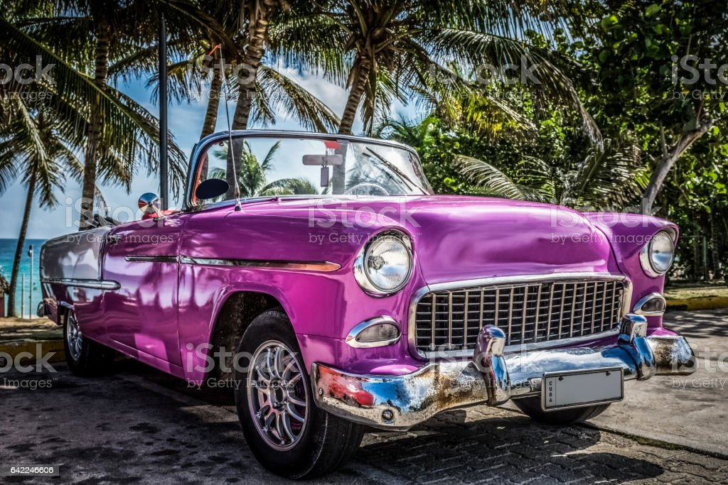 aHDR  American vintage car parked under palms in Varadero Cuba stock photo