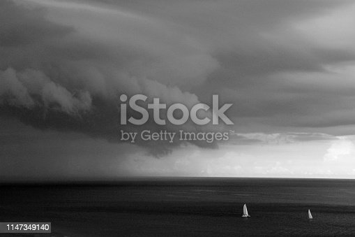 Ahead of a Thunderstorm over the Atlantic Ocean with Dramatic Sky Captured in black and white