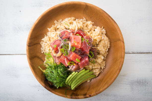 ahi poke bowl on brown rice stock photo