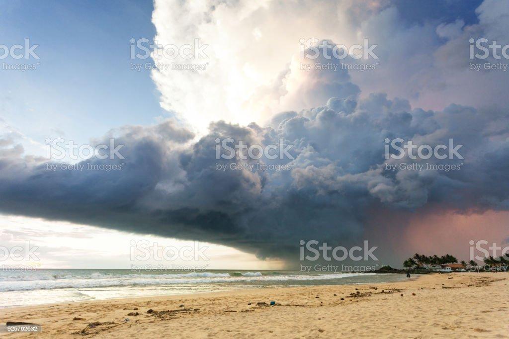 Ahungalla Beach, Sri Lanka - A gigantic storm cloud above the beach of Ahungalla stock photo