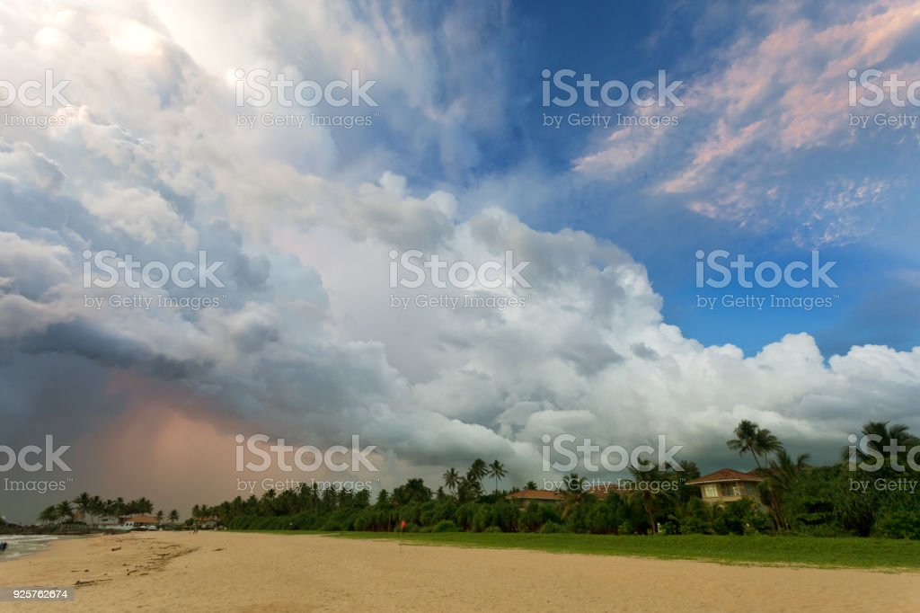 Ahungalla Beach, Sri Lanka - Huge clouds and various light during sunset at the beach of Ahungalla stock photo