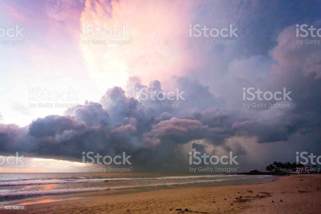 Ahungalla Beach, Sri Lanka - Illuminated clouds and light during sunset at the beach of Ahungalla stock photo