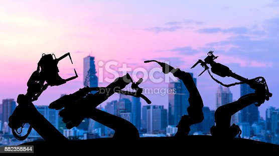 istock Ai assistant technology , industry 4.0 , artificial intelligence trend concept. Silhouette of automation robot arms. Blur metropolis city building background. 882358844