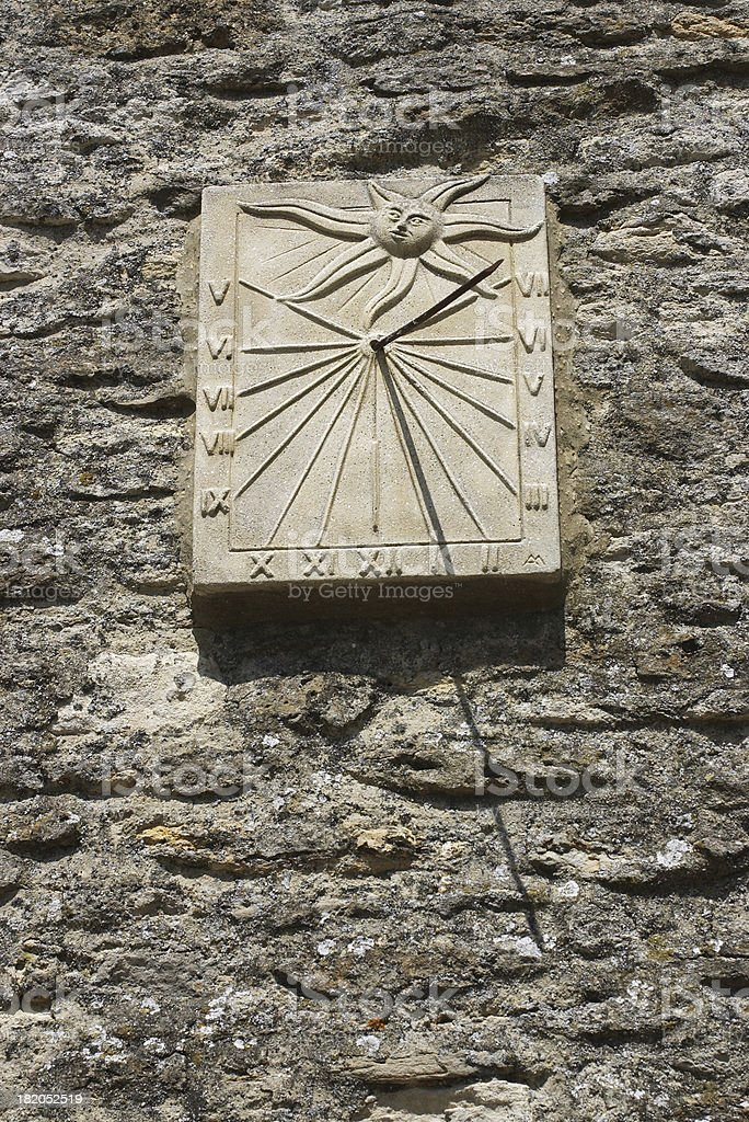 Stone sundial on a wall Lechlade church royalty-free stock photo