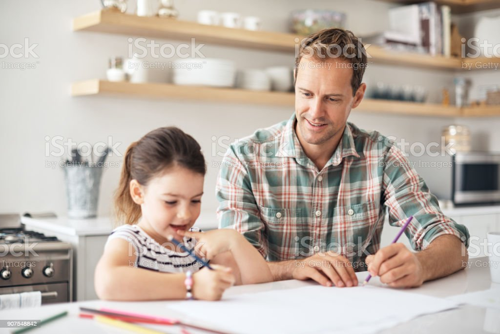 Aiding his daughter's bright imagination stock photo
