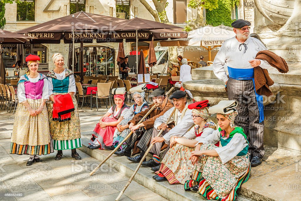 People in traditional clothing in the main square of Aigues-Mortes,...